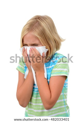 young girl sneezing with tissue isolated white background