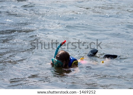 Young girl snorkeling - stock photo