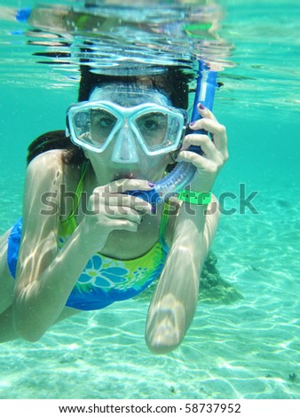 Young girl snorkeling in the Caribbean - stock photo