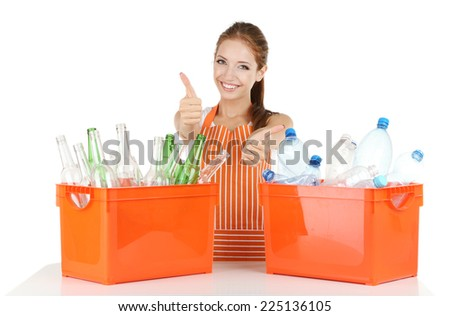 Young girl sorting glass and plastic bottles isolated on white - stock photo