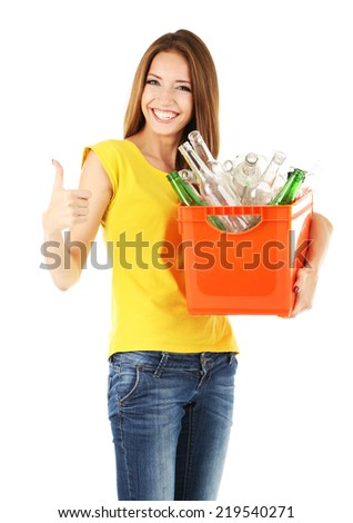 Young girl sorting glass bottles isolated on white - stock photo