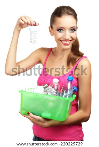 Young girl sorting lamps and bottles isolated on white - stock photo