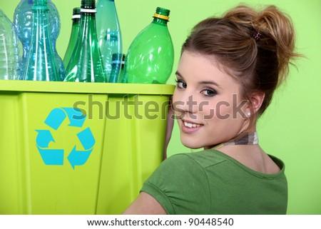 Young girl sorting plastic bottles - stock photo