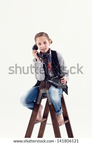 Young girl speaking on the phone - stock photo