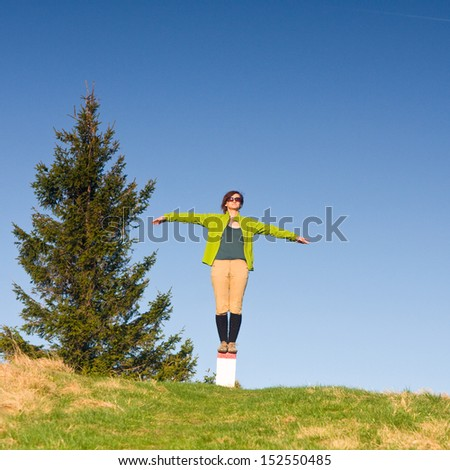 Young girl spreading hands with joy - stock photo