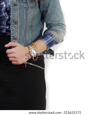young girl standing and wearing watch closeup isolated