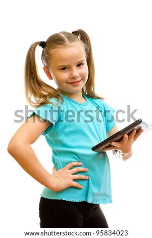 Young girl standing, holding, and looking at tablet PC device.