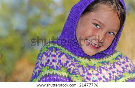 Young girl staying warm outdoors - stock photo
