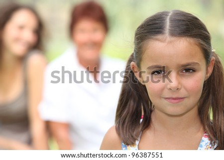Young girl stood with family in background