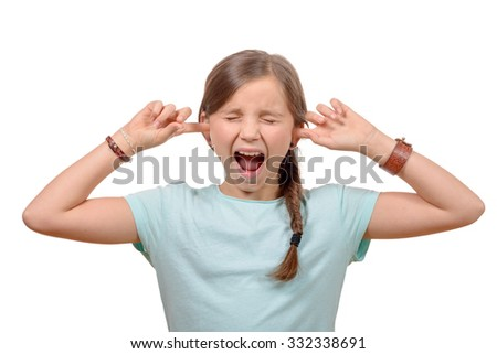 young girl stops his ears with his hands and closes her eyes on white background