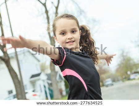 Young girl street jogging - stock photo