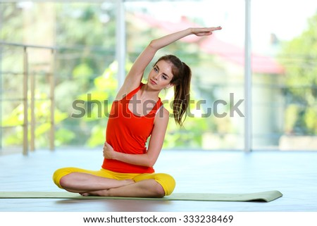 Young girl stretching in the gym - stock photo