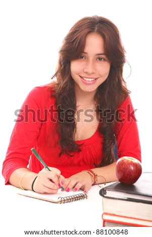 Young girl studying and  looking at the camera - stock photo