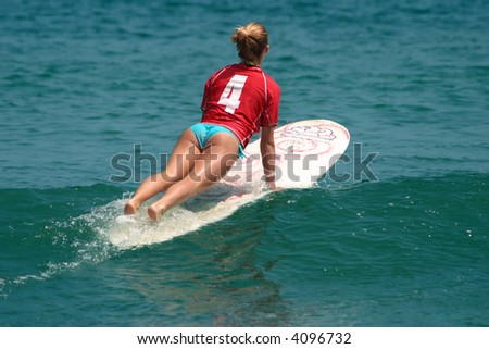 Young girl surfing on Malibu Beach, California - stock photo