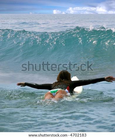 Young girl surfing on Malibu Beach, California - stock photo