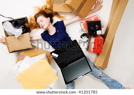 Young girl surrounded with her delivered online orders - stock photo