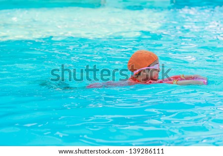 young girl swimming in the pool