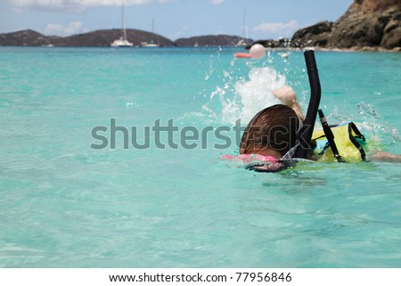 Young girl swims with snorkeling gear, St. John - stock photo