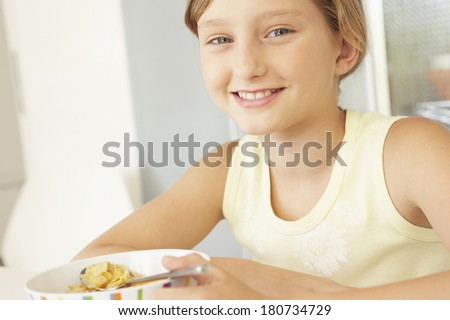 Young girl taking breakfast in the morning - stock photo