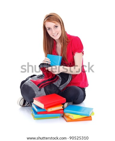 Young girl taking out the books from her bag