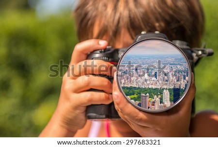 Young girl taking photos of Central Park by professional digital camera. - stock photo
