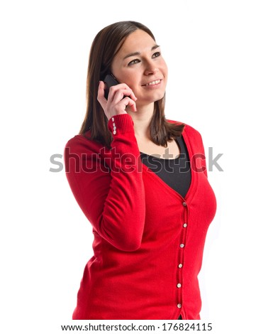 Young girl talking on mobile over white background
