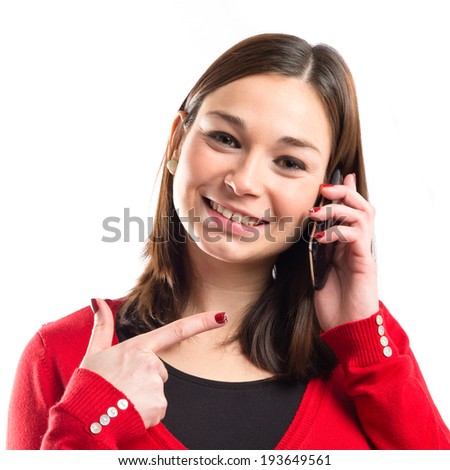 Young girl talking on mobile over white background - stock photo