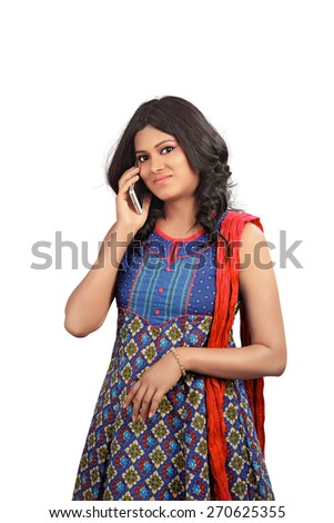 Young girl talking on mobile phone against white background - stock photo