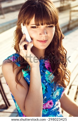Young girl talking on the phone - stock photo