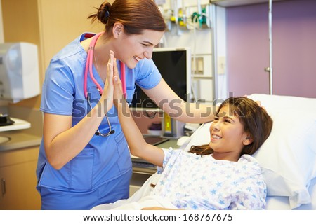 Young Girl Talking To Female Nurse In Hospital Room - stock photo