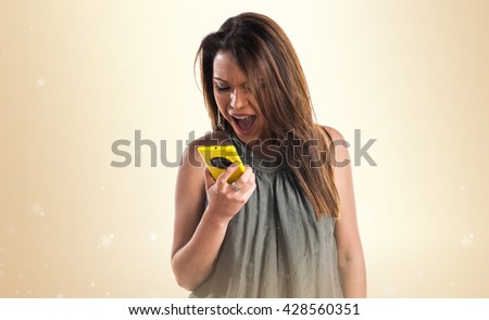 Young girl talking to mobile - stock photo