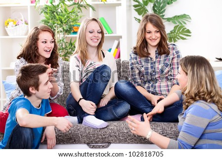 young girl talking with her friends - stock photo