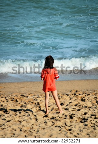 young girl  teenager standing on seacoast - stock photo