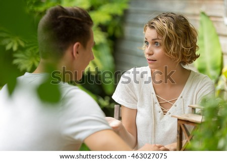 young girl telling a story to her boyfriend