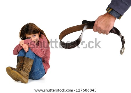 Young girl terrified od her father's physical punishment with a belt - stock photo