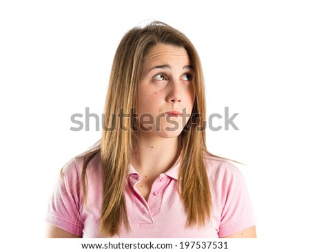 Young girl thinking over isolated white background