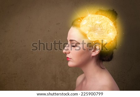 Young girl thinking with glowing brain illustration on grungy background - stock photo
