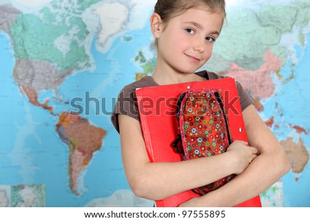 Young girl thirsty for knowledge - stock photo