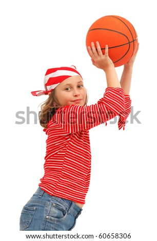 Young girl throwing with basket ball - stock photo
