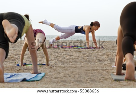 Young girl training on the beach - stock photo