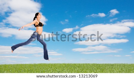 Young girl try a fly in summer day