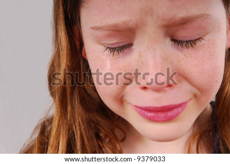 Young girl upset, crying with tears - stock photo