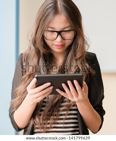 young girl uses a digital tablet - stock photo