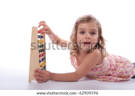 Young girl using abacus confidently - stock photo