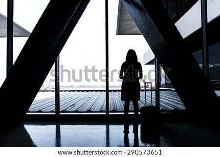 Young girl waiting for flight aircraft  - stock photo