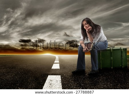 young girl waiting on the road - stock photo
