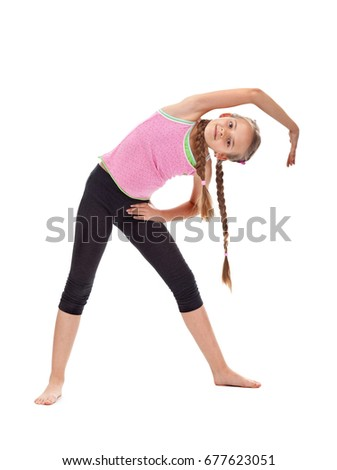 Young girl warming up doing stretching and flexibility gymnastic exercises - isolated