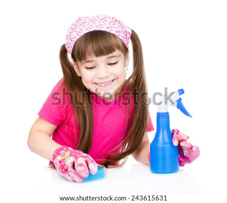 young girl washes table. isolated on white background - stock photo