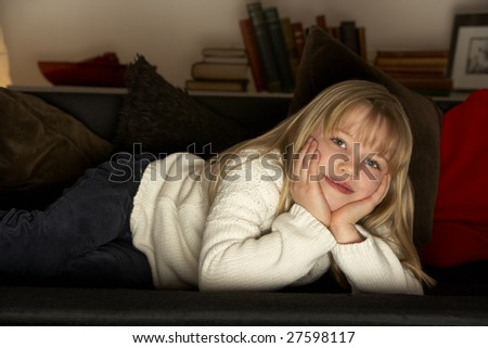 Young Girl Watching Television - stock photo
