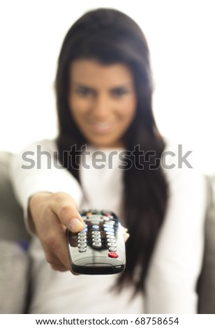 young girl watching tv using a remote control - stock photo